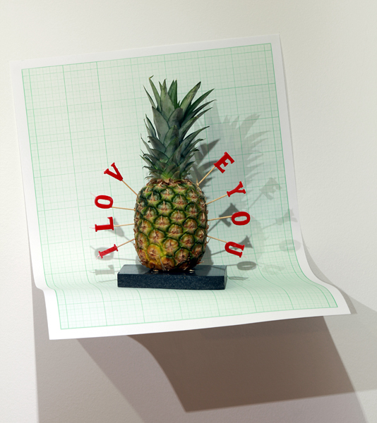 I L O V ‑ E Y O U / Pineapple, candles, marble support, paper background, light / Dimensions: 40 x 25 x 60 cm 2012, Budapest, Trapéz Gallery